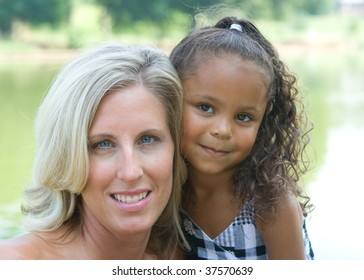 A mother and her mixed race daughter enjoying the park