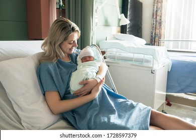 A Mother with her newborn baby at the hospital a day after a natural birth labor