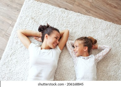 Mother with her preteen daughter at home