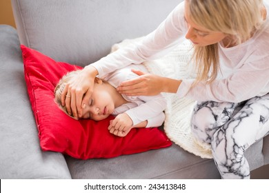 Mother with her sick kid at home