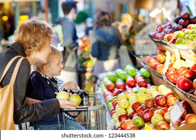 mother and her son buying fruits at a farmers market