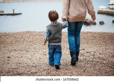 Mother and her son by the sea