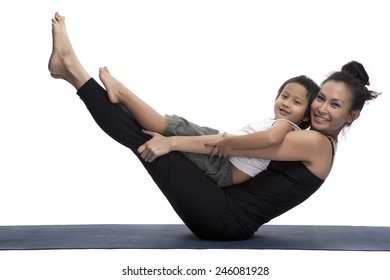 Mother and her son doing yoga exercise on studio white background.