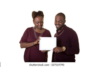 A mother and her son holding a tablet, isolated on white