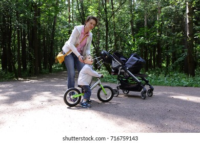 Mother with her son looking at bird in the park