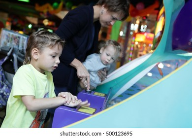 Mother and her sons playing at amusement park