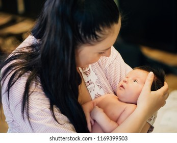 Mother and her sweet baby in the room at home