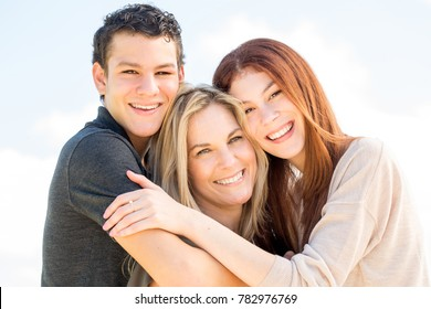 Mother with her teenage children.