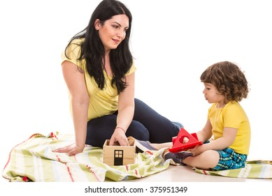 Mother and her toddler son having conversation home