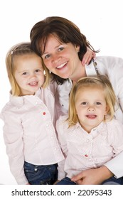 mother with her two twin daughters