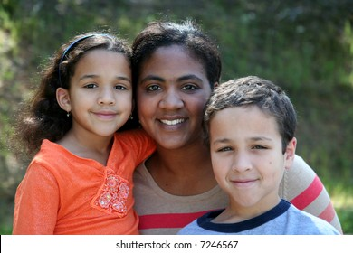 A mother with her young children of a mixed race family