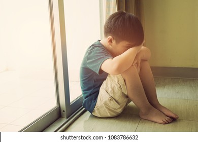 mother hit her kid, children crying, little boy cry, feeling sad, young boy unhappy, family violence concept, selective focus and soft focus