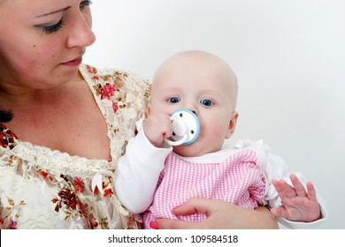 mother holding a baby daughter. studio photography
