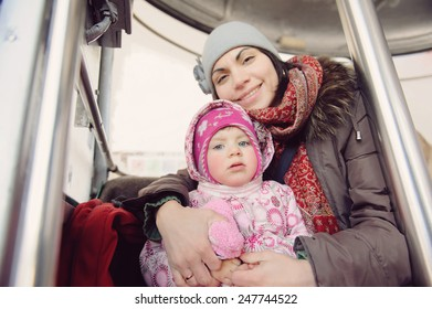 mother holding baby in funicular