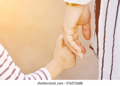 Mother holding a child's hand