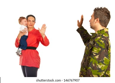 Mother holding crying baby and say goodbye to her military husband which goes back to the army isolated on white background