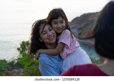Mother holding daughter Happy smile