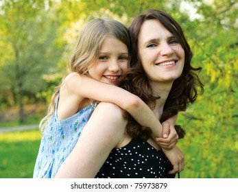 Mother holding the girl on the back