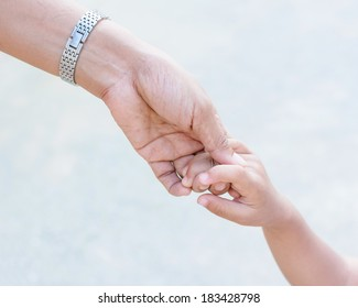 Mother holding a hand of child
