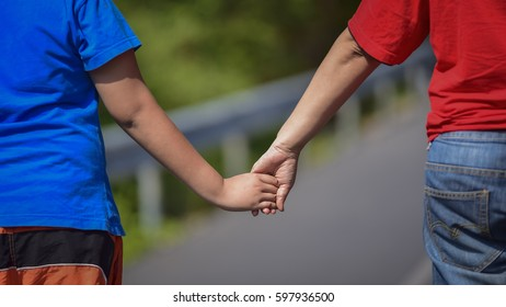 Mother holding hand  to go together.