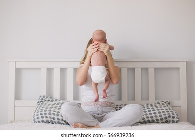 Mother holding her newborn baby in the hands.