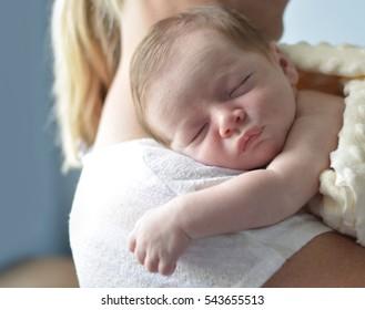 Mother holding her newborn child