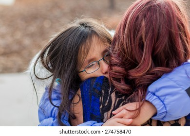 Mother holding her young daughter at a park in Reno, Nevada, USA.