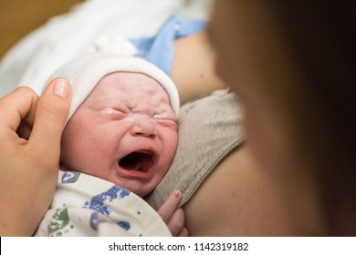 Mother holding newborn baby for the first time