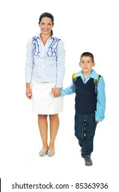 Mother holding son hand,talking  and going together in first day of school