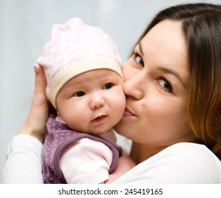 Mother holds cute 3 months baby