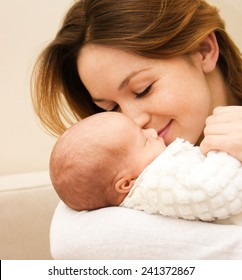 Mother holds cute newborn baby