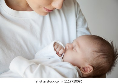 mother holds her child in her hands