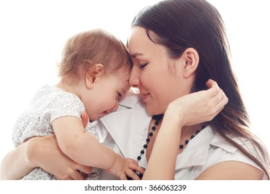 mother holds her little girl isolated over white fashion toned