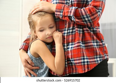 633f81f4eba Mother hugging cute little girl