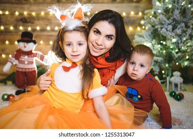 mother hugging festive daughter and son
