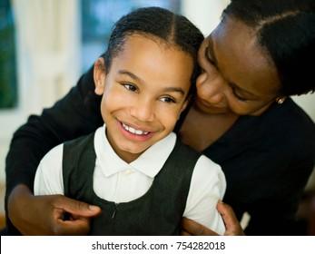 A mother hugging her little girl