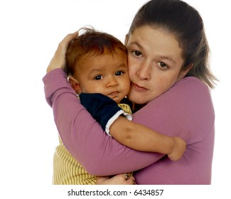 A mother hugging her six-month biracial son.