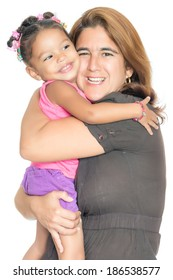 Mother hugging her small multiracial daughter with a smile isolated on white