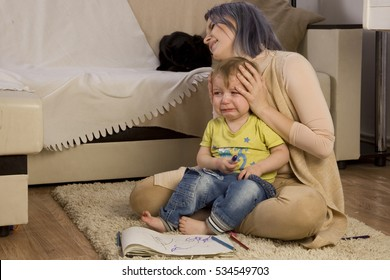 mother hugs a child, soothing, stroking the head. Baby is cry. children's hysterical moods, bad mother, naughty child, parenting difficulties. Child psychology. postpartum depression