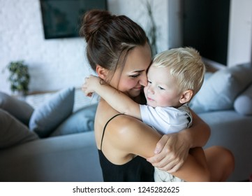 Mother hugs her son. Time with family at home.
