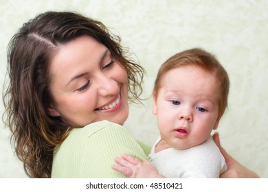 Mother keeps son in his hands