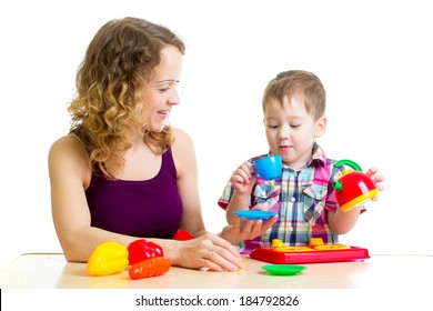 mother and kid boy playing together