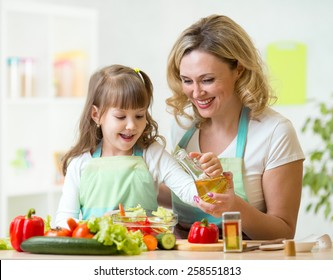mother and kid girl preparing healthy food at home