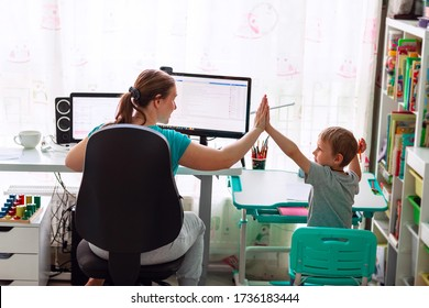 Mother with kid trying to work from home during quarantine. Stay at home, work from home concept during coronavirus pandemic