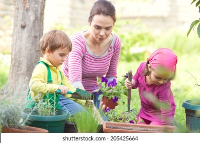 Mother and kids gardening