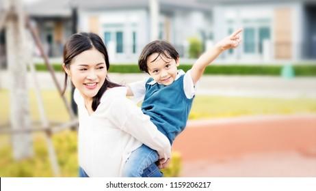 Mother and kids are going to send their children to the school bus.Kids shoulder schoolbag.Back to school,primary school,Kindergarten