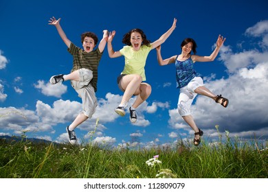 Mother with kids jumping outdoor