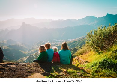 Mother with kids travel in mountains, family hiking in nature