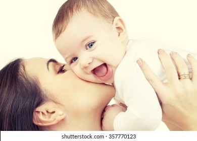mother kissing her baby