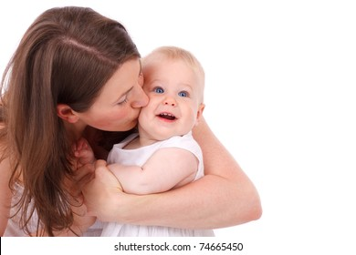 mother kissing her baby daughter isolated on white background